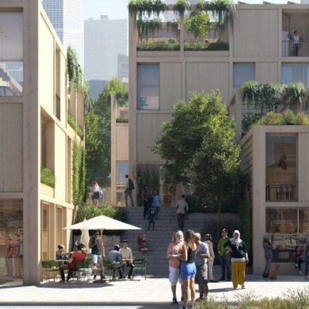 Op de afbeelding is het volgende afgebeeld: mensen die praten in de openbare ruimte. Een terras met mensen. Deelfietsen. Gebouwen waarin planten zijn verwerkt.